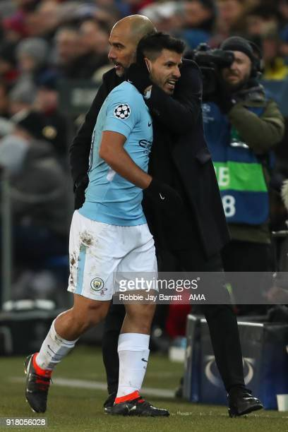Sergio Aguero of Manchester City and Pep Guardiola the head coach / manager of Manchester City celebrate during the UEFA Champions League Round of 16...