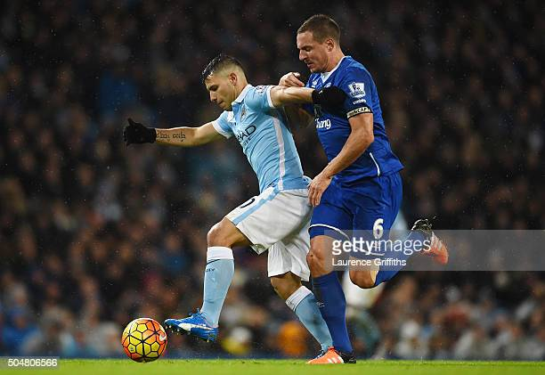 Sergio Aguero of Manchester City and Phil Jagielka of Everton compete for the ball during the Barclays Premier League match between Manchester City...