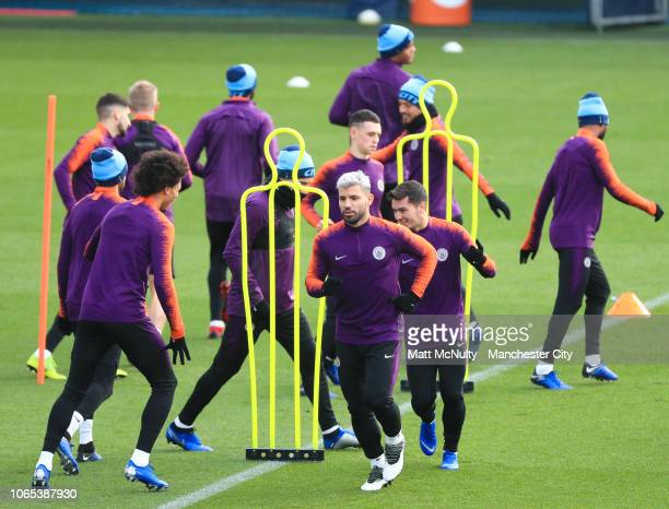 Sergio Aguero of Manchester City and teammates warm up during a training session at Manchester City Football Academy on November 26 2018 in...