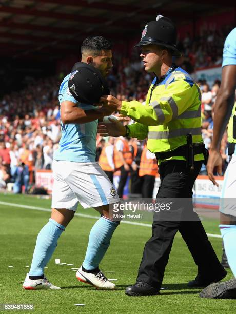 Sergio Aguero of Manchester City argues with a police man during the Premier League match between AFC Bournemouth and Manchester City at Vitality...