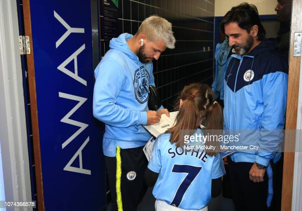 Sergio Aguero of Manchester City arrives at the stadium and signs a programme for fans ahead of the Carabao Cup Quarter Final match between Leicester...