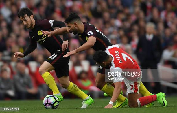 Sergio Aguero of Manchester City atempts to get past Alexis Sanchez of Arsenal during the Premier League match between Arsenal and Manchester City at...