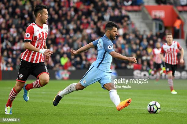 Sergio Aguero of Manchester City attempts to get away from Maya Yoshida of Southampton during the Premier League match between Southampton and...