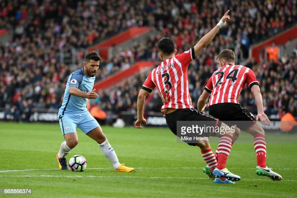 Sergio Aguero of Manchester City attempts to get past Maya Yoshida of Southampton and Jack Stephens of Southampton during the Premier League match...