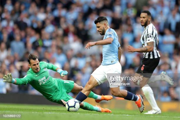 Sergio Aguero of Manchester City attempts to take the ball around Martin Dubravka of Newcastle United during the Premier League match between...