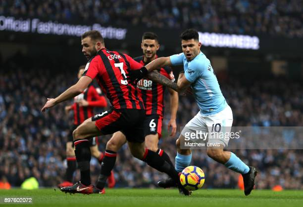 Sergio Aguero of Manchester City battles for possesion with Steve Cook of AFC Bournemouth during the Premier League match between Manchester City and...