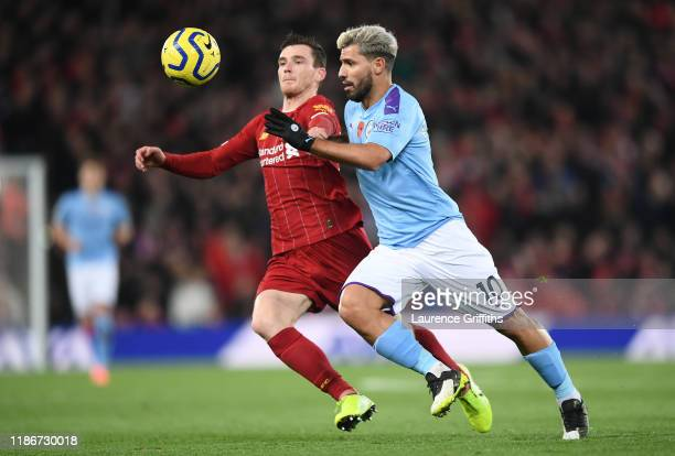 Sergio Aguero of Manchester City battles for possession with Andy Robertson of Liverpool during the Premier League match between Liverpool FC and...