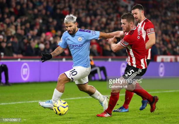 Sergio Aguero of Manchester City battles for possession with Jack O'Connell of Sheffield United during the Premier League match between Sheffield...
