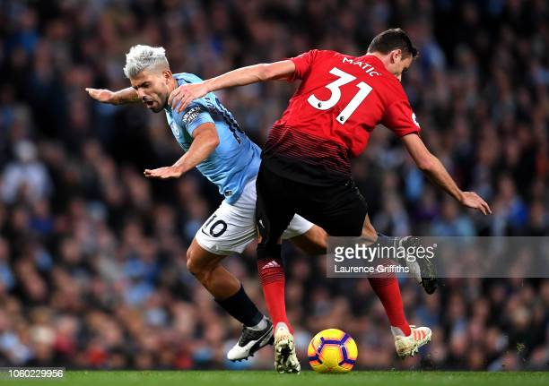 Sergio Aguero of Manchester City battles for possession with Nemanja Matic of Manchester United during the Premier League match between Manchester...