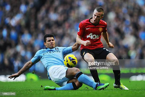 Sergio Aguero of Manchester City battles for the ball with Tom Cleverley of Manchester United during the Barclays Premier League match between...