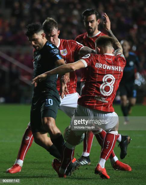 Sergio Aguero of Manchester City battles with Josh Brownhill and Aden Flint of Bristol City during the Carabao Cup semifinal second leg match between...