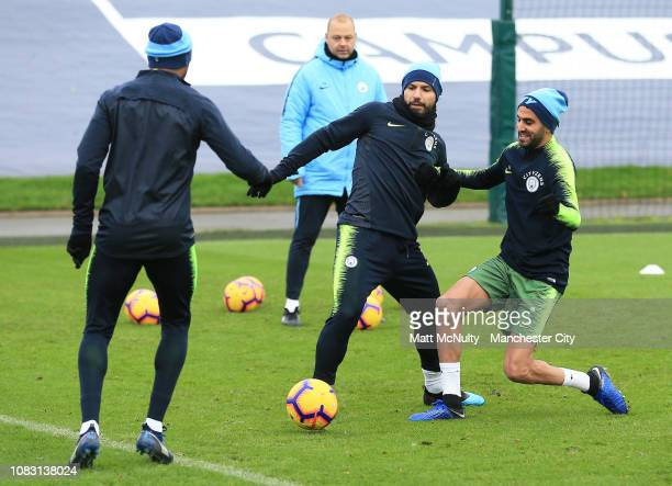 Sergio Aguero of Manchester City battles with Riyad Mahrez during the training session at Manchester City Football Academy on January 15 2019 in...