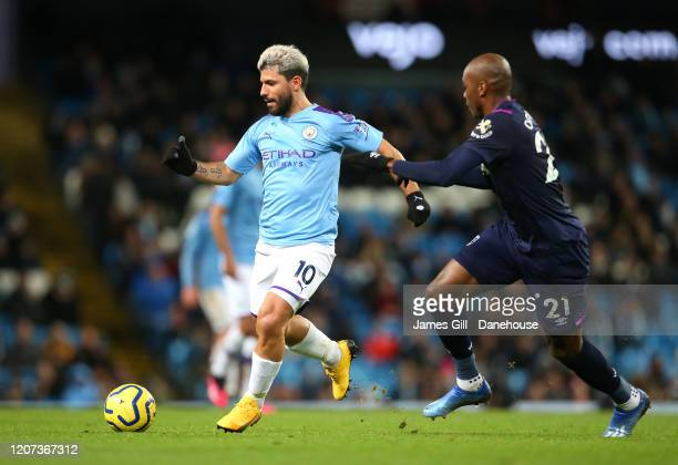 Sergio Aguero of Manchester City beats Angelo Ogbonna of West Ham United during the Premier League match between Manchester City and West Ham United...