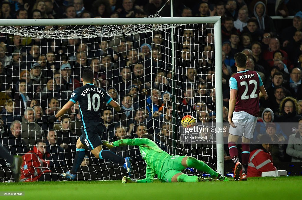 Sergio Aguero of Manchester City beats goalkeeper Adrian of West Ham United to score their second goal during the Barclays Premier League match between West Ham United and Manchester City at the Boleyn Ground on January 23, 2016 in London, England.