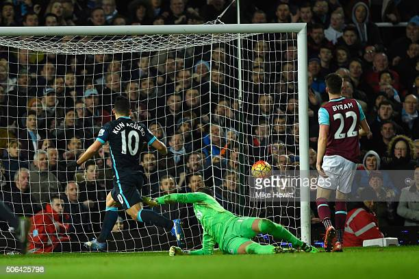 Sergio Aguero of Manchester City beats goalkeeper Adrian of West Ham United to score their second goal during the Barclays Premier League match...
