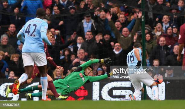 Sergio Aguero of Manchester City beats Jonathan Bond of Watford to score his first goal during the FA Cup Fourth Round match sponsored by Budweiser...