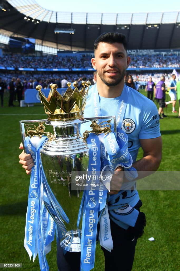 Sergio Aguero of Manchester City celebrate with The Premier League Trophy after the Premier League match between Manchester City and Huddersfield Town at Etihad Stadium on May 6, 2018 in Manchester, England.