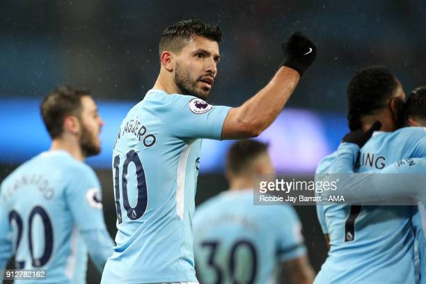 Sergio Aguero of Manchester City celebrates after scoring a goal to make it 30 during the Premier League match between Manchester City and West...