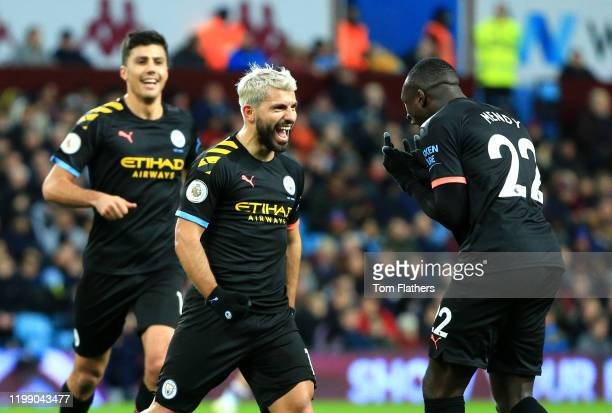 Sergio Aguero of Manchester CIty celebrates after scoring his sides third goal with team mates during the Premier League match between Aston Villa...