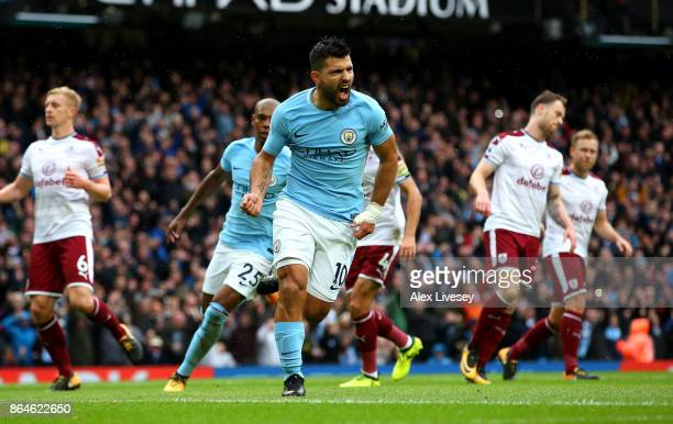 Sergio Aguero of Manchester City celebrates after scoring his sides first goal during the Premier League match between Manchester City and Burnley at...
