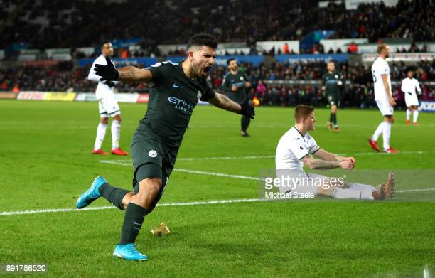 Sergio Aguero of Manchester City celebrates after scoring his sides fourth goal during the Premier League match between Swansea City and Manchester...