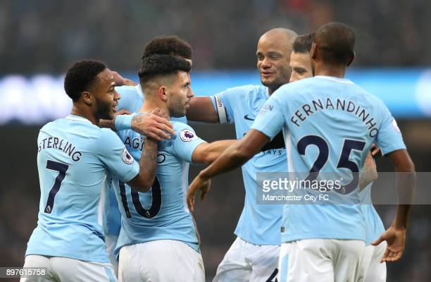 Sergio Aguero of Manchester City celebrates after scoring his sides first goal with his team mates during the Premier League match between Manchester...