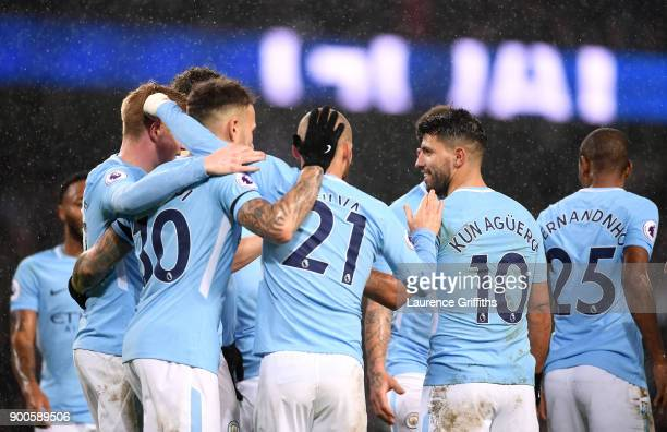 Sergio Aguero of Manchester City celebrates after scoring his sides third goal with his Manchester City team mates during the Premier League match...