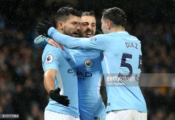 Sergio Aguero of Manchester City celebrates after scoring his sides third goal with Bernardo Silva of Manchester City and Brahim Diaz of Manchester...