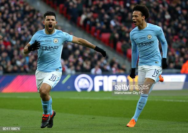Sergio Aguero of Manchester City celebrates after scoring his sides first goal with team mate Leroy Sane of Manchester City during the Carabao Cup...