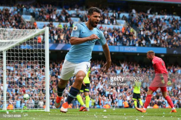 Sergio Aguero of Manchester City celebrates after scoring his team's third goal during the Premier League match between Manchester City and...