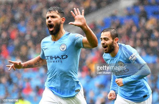 Sergio Aguero of Manchester City celebrates after scoring his team's first goal during the Premier League match between Cardiff City and Manchester...