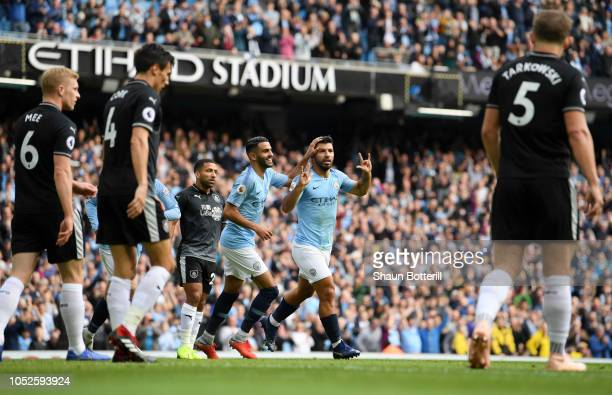 Sergio Aguero of Manchester City celebrates after scoring his team's first goal with Riyad Mahrez of Manchester City during the Premier League match...