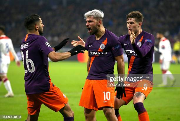 Sergio Aguero of Manchester City celebrates after scoring his team's second goal with Riyad Mahrez and John Stones during the UEFA Champions League...