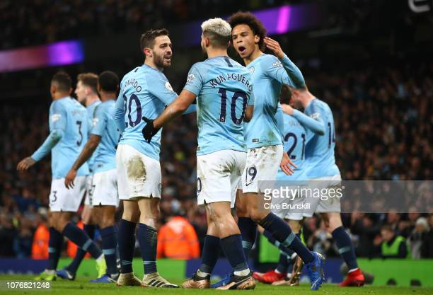 Sergio Aguero of Manchester City celebrates after scoring his team's first goal with Bernardo Silva of Manchester City and Leroy Sane of Manchester...