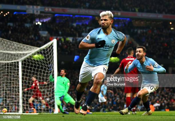 Sergio Aguero of Manchester City celebrates after scoring his team's first goal during the Premier League match between Manchester City and Liverpool...