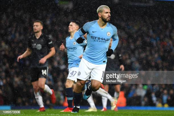 Sergio Aguero of Manchester City celebrates after scoring his team's fifth goal during the FA Cup Fourth Round match between Manchester City and...