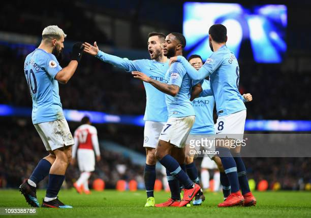 Sergio Aguero of Manchester City celebrates after scoring his team's second goal with team mates Bernardo Silva and Raheem Sterling during the...
