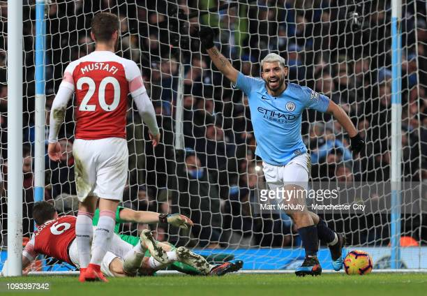 Sergio Aguero of Manchester City celebrates after scoring his team's third goal during the Premier League match between Manchester City and Arsenal...