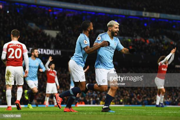 Sergio Aguero of Manchester City celebrates after scoring his team's third goal with Raheem Sterling during the Premier League match between...