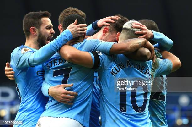 Sergio Aguero of Manchester City celebrates after scoring his team's third goal with his team mates during the Premier League match between...