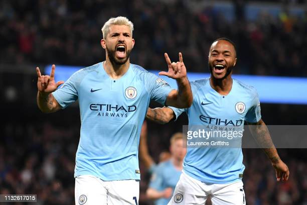 Sergio Aguero of Manchester City celebrates after scoring his team's first goal with Raheem Sterling of Manchester City during the Premier League...
