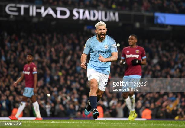 Sergio Aguero of Manchester City celebrates after scoring his team's first goal during the Premier League match between Manchester City and West Ham...