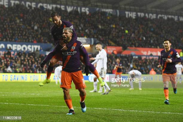 Sergio Aguero of Manchester City celebrates after scoring his team's third goal with Bernardo Silva of Manchester City during the FA Cup Quarter...
