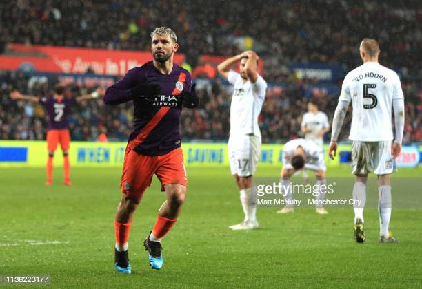 Sergio Aguero of Manchester City celebrates after scoring his team's third goal during the FA Cup Quarter Final match between Swansea City and...