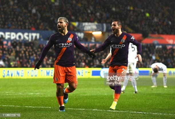 Sergio Aguero of Manchester City celebrates after scoring his team's third goal with Bernardo Silva of Manchester City during the FA Cup Quarter...