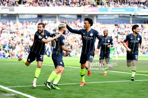 Sergio Aguero of Manchester City celebrates after scoring his team's first goal with Bernardo Silva and Leroy Sane during the Premier League match...