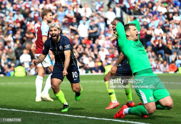 Sergio Aguero of Manchester City celebrates after scoring his team's first goal as Tom Heaton of Burnley reacts during the Premier League match...