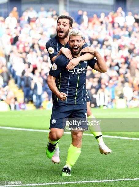 Sergio Aguero of Manchester City celebrates after scoring his team's first goal with Bernardo Silva during the Premier League match between Burnley...