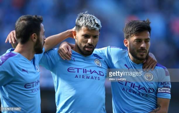 Sergio Aguero of Manchester City celebrates after scoring his team's second goal with Bernardo Silva and David Silva during the Premier League match...