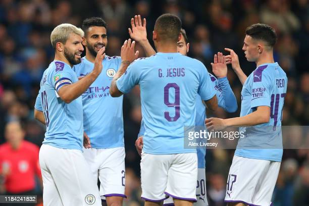 Sergio Aguero of Manchester City celebrates after scoring his team's third goal with Riyad Mahrez Gabriel Jesus Bernardo Silva and Phil Foden of...